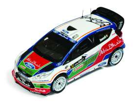IXO Models - Ford  - ixram463 : 2011 Ford Fiesta WRC #3 M.Simoncelli UK Test Kirkbride Airfield, blue/white/green/red