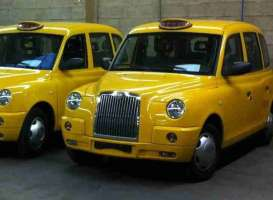 London TX Taxi Cab  - 2007 sunburst yellow - 1:18 - SunStar - 5254 - sun5254 | Tom's Modelauto's
