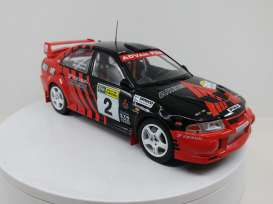 Mitsubishi  - Lancer EVO VI #2 1999 red/black - 1:18 - Triple9 Collection - 1800210 - T9-1800210 | Tom's Modelauto's