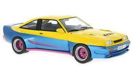 Opel  - 1991 yellow/blue - 1:18 - MCG - MCG18095 | Toms Modelautos